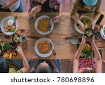 enjoying dinner with friends.... | Shutterstock . vector #780698896