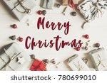 merry christmas text flat lay.... | Shutterstock . vector #780699010