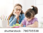 young smiling teacher and... | Shutterstock . vector #780705538