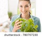 young woman growing fresh herbs ... | Shutterstock . vector #780707230