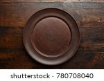 empty flat clay plate on a...   Shutterstock . vector #780708040