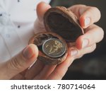 euro coins in a nut shell. the... | Shutterstock . vector #780714064