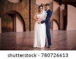 handsome groom hugging his... | Shutterstock . vector #780726613
