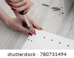 a woman holds a furniture nut ...   Shutterstock . vector #780731494