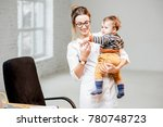 young woman pediatrician in... | Shutterstock . vector #780748723