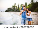 beautiful young family on...   Shutterstock . vector #780770056
