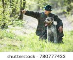 hunter with a dog in the forest.... | Shutterstock . vector #780777433