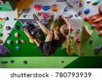 young woman bouldering in... | Shutterstock . vector #780793939