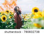 young asia girl in sunflower...   Shutterstock . vector #780832738