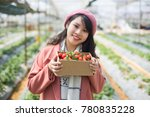 young asian girl in strawberry...   Shutterstock . vector #780835228