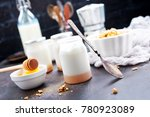 yogurt with granola on a table  ... | Shutterstock . vector #780923089