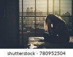 depressed women sitting head in ... | Shutterstock . vector #780952504