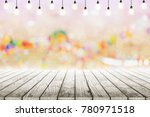 empty wooden table with light... | Shutterstock . vector #780971518