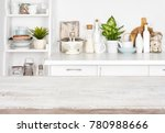 wooden table over blurred image ... | Shutterstock . vector #780988666