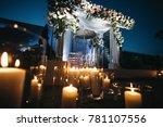 flower garland hangs before... | Shutterstock . vector #781107556