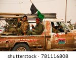 Small photo of Libyan rebels travel to a battle line where they will fight Colonel Muammar Gaddafi's army. Ajdabiya, Libya, April 7, 2011