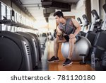 young fitness man lifting... | Shutterstock . vector #781120180