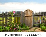 Wooden Gate. Roses On The Fenc...