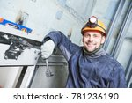 smiling machinist with spanner... | Shutterstock . vector #781236190