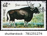 Small photo of LAOS - CIRCA 1990: a stamp printed in Laos shows kouprey, bos sauveli, wild bovine species from Southeast Asia, circa 1990