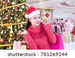 beautiful woman wearing santa... | Shutterstock . vector #781269244