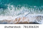 aerial view of waves and beach... | Shutterstock . vector #781306324