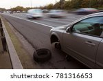 car with flat tyre stopped on... | Shutterstock . vector #781316653