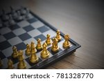 gold and silver chessmen on... | Shutterstock . vector #781328770