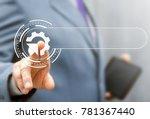 Small photo of Integration Web Search Information Technology Template concept. Businessman using virtual modern touchscreen presses cogwheel arrow button. Integrate Internet Service.