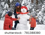 winter fun. a girl  a man and a ... | Shutterstock . vector #781388380