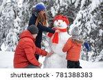 winter fun. a girl  a man and a ... | Shutterstock . vector #781388383