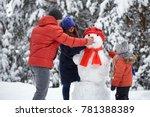 winter fun. a girl  a man and a ... | Shutterstock . vector #781388389