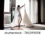pretty brunette bride in silk... | Shutterstock . vector #781395058