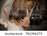 stylish young groom gently... | Shutterstock . vector #781396273