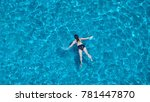 people swimming in the hotel... | Shutterstock . vector #781447870