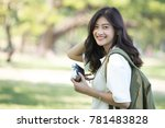 attractive asian woman holding... | Shutterstock . vector #781483828