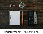 glasses and a pen on the table. ... | Shutterstock . vector #781544128
