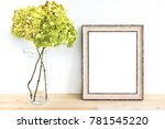 wooden frame mockup with green... | Shutterstock . vector #781545220