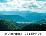 beautiful green hills under... | Shutterstock . vector #781554406