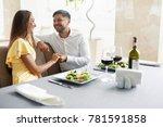 romantic couple having dinner... | Shutterstock . vector #781591858