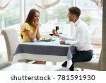proposal in restaurant. man... | Shutterstock . vector #781591930