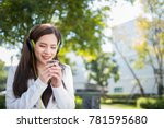Small photo of Young woman take a break from a hot coffee in the winter with light music easy listening song.