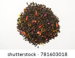 Small photo of Aromatic, pungent, black tea with dry berries and flowers. Top view.