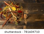 Small photo of Set of spices on wooden background. Wood spoons with pepper balls, paprika, curry and dry spices laid by cinnamon and anise stars. Composition of condiment, copy space. Cuisine and flavouring concept