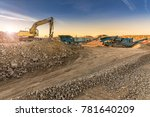 Small photo of Excavator and machine to pulverize stone in a quarry