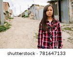 Stock photo portrait of beautiful girl in shanty town poor infant concept 781647133