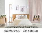 big bed with white bedding in... | Shutterstock . vector #781658860
