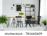 black chairs at dining table in ... | Shutterstock . vector #781660609