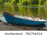 boat on the sandy bank of the... | Shutterstock . vector #781746514
