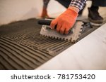 troweling mortar onto a... | Shutterstock . vector #781753420